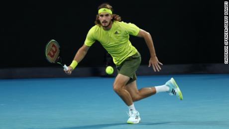 Tsitsipas plays a forehand against Nadal.