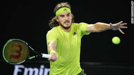 Tsitsipas hits a forehand return to Medvedev during their semifinal match.