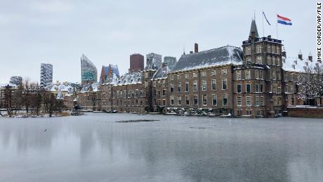 The frozen Hofvijver pond is seen outside the Dutch parliament buildings in The Hague, Netherlands, Tuesday, February 9.