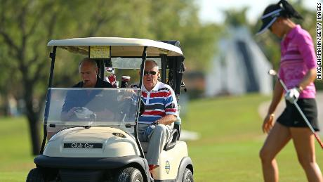 Former New York City Mayor Rudy Guliani and Rush Limbaugh look on as Michelle Wie plays during the Els for Autism Pro-am at The PGA National Golf Club  on March 10, 2014 in Palm Beach, Florida.
