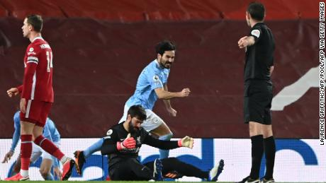 Gundogan celebrates scoring his team's second goal against Liverpool.