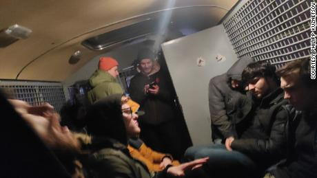 Detainees were forced to wait in cramped police vans as there is no space at detention centers.