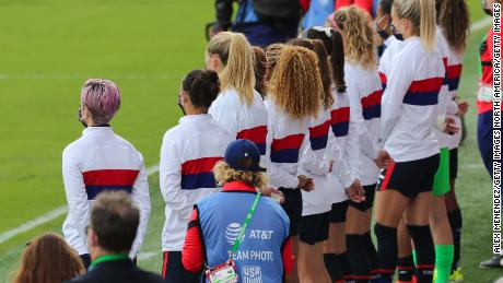 The USWNT remained standing for the national anthem on Sunday.