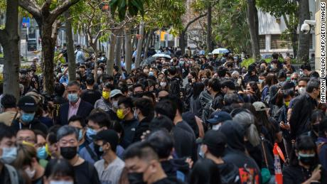 Supporters wait outside West Kowloon court in Hong Kong on March 1, 2021.