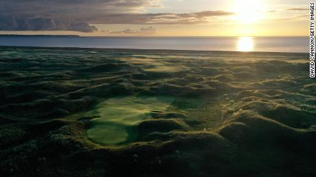 An aerial view of the par 4, eighth hole looking back to the tee from the green as the sun rises at The Royal St. George's Club.