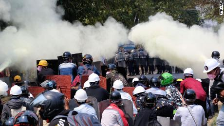 Anti-coup protesters discharge fire extinguishers to counter the impact of the tear gas fired by police during a demonstration in Naypyitaw, Myanmar, on March 8.