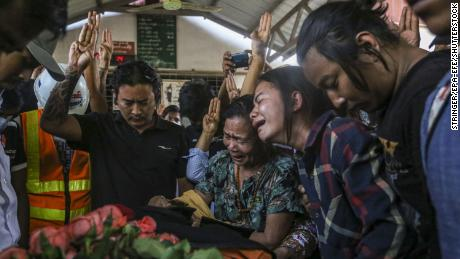 Relatives and friends react during the funeral procession of Ko Saw Pyae Naing, 21, who died in the anti-coup protests, in Mandalay, Myanmar, on March 14.