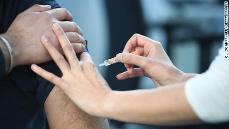 A pharmacist  administers an AstraZeneca Covid-19 vaccine injection at the Black Country Living Museum in Dudley, central England, on January 25, 2021.