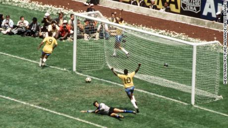 Carlos Alberto and Pelé celebrate an iconic goal marking the final score of 4-1 as Brazil beat Italy to win the World Cup for a third time.