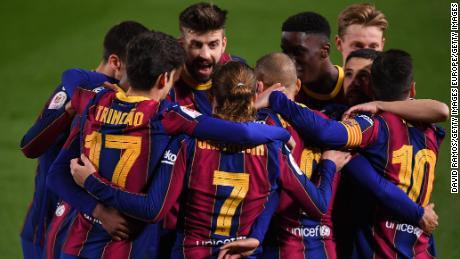 Barcelona players celebrate Martin Braithwaite's winner against Sevilla.