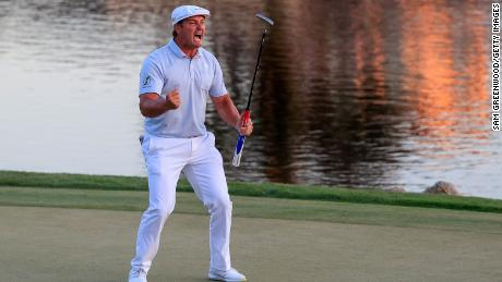 DeChambeau celebrates making his putt on the 18th green to win the Arnold Palmer Invitational.