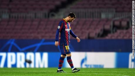 Lionel Messi trudges off after Barcelona's recent hammering at the hands of PSG.