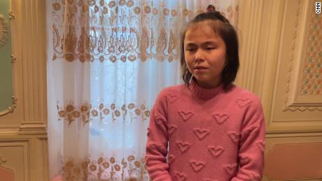 Mamutjan's daughter Muhlise breaks down after being asked  about her parents by CNN at her grandparents' home in Kashgar, Xinjiang, in March 2021.