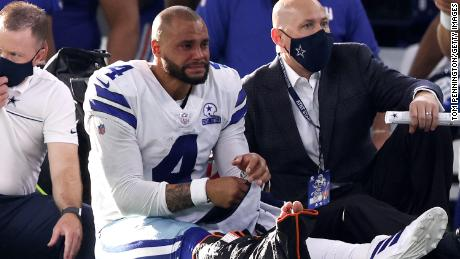 Prescott is carted off the field after sustaining a leg injury against the New York Giants.