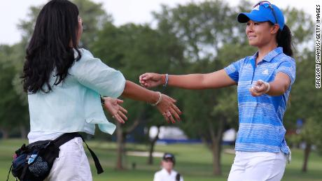 Kang hugs her mom Grace Lee after winning the the 2017 KPMG PGA Championship.
