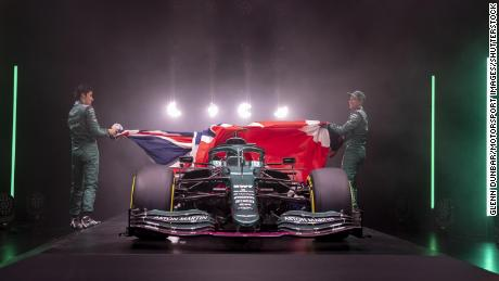Lance Stroll and Sebastian Vettel unveil the new Aston Martin AMR21.