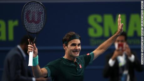 Federer celebrates his victory in Doha.