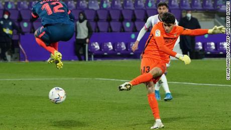Yassine Bono calmly slots the ball home.