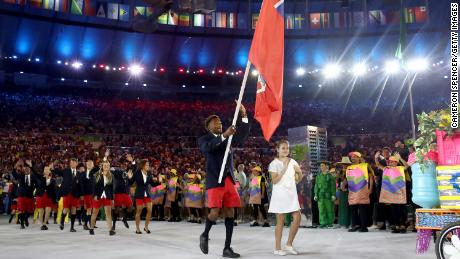 Tyrone Smith carries the flag for Bermuda during the opening ceremony of the Rio 2016 Olympics.