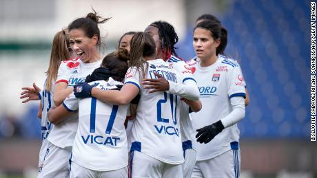 Lyon players celebrate scoring against Broendby IF in the Women's Champions League.