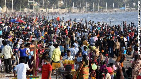 People enjoy warm weather at Juhu Beach in Mumbai, India, on April 4.