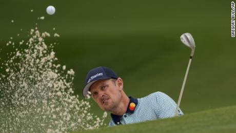 Justin Rose hits out of a bunker on the seventh hole during the second round of the Masters.