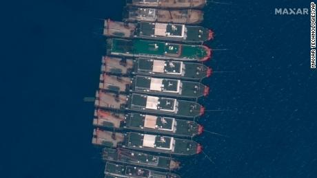 This satellite image provided by Maxar Technologies shows Chinese vessels anchored the Whitsun Reef located in the disputed South China Sea. Tuesday, March 23, 2021.