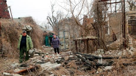 Residents return to look for belongings in their destroyed home near a front line in eastern Ukraine earlier this month.
