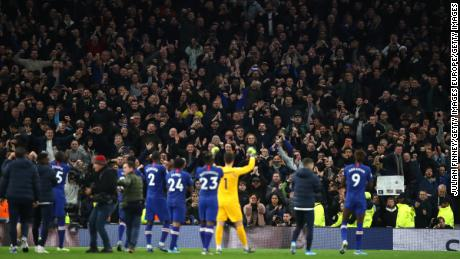 Chelsea players applaud their fans following victory during the Premier League match against Tottenham Hotspur.