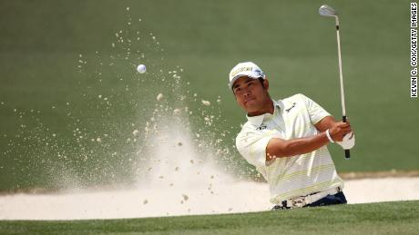 Matsuyama plays a shot from a bunker on the second hole during the final round of the Masters.