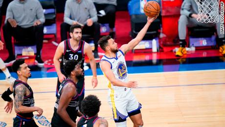 Curry goes for a shot during the first half of the game against the Philadelphia 76ers.