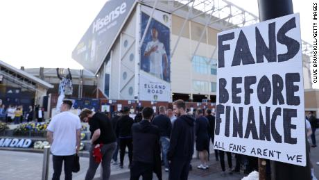 """A fan sign is seen reading """"Fans before finance, All fans aren't we"""" as a protest against the European Super League outside Elland Road prior to the match between Leeds United and Liverpool on April 19."""