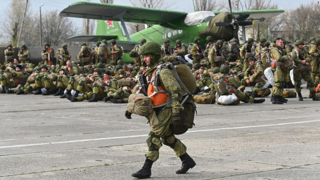 Russia orders troops back to base after massive buildup near Ukraine border