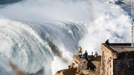 Photographers capture a giant swell at Nazaré last October.