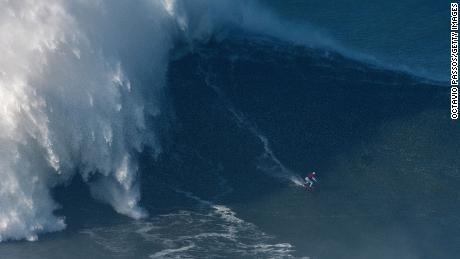 Gabeira drops into a wave at Praia do Norte, Portugal, on January 18, 2018.