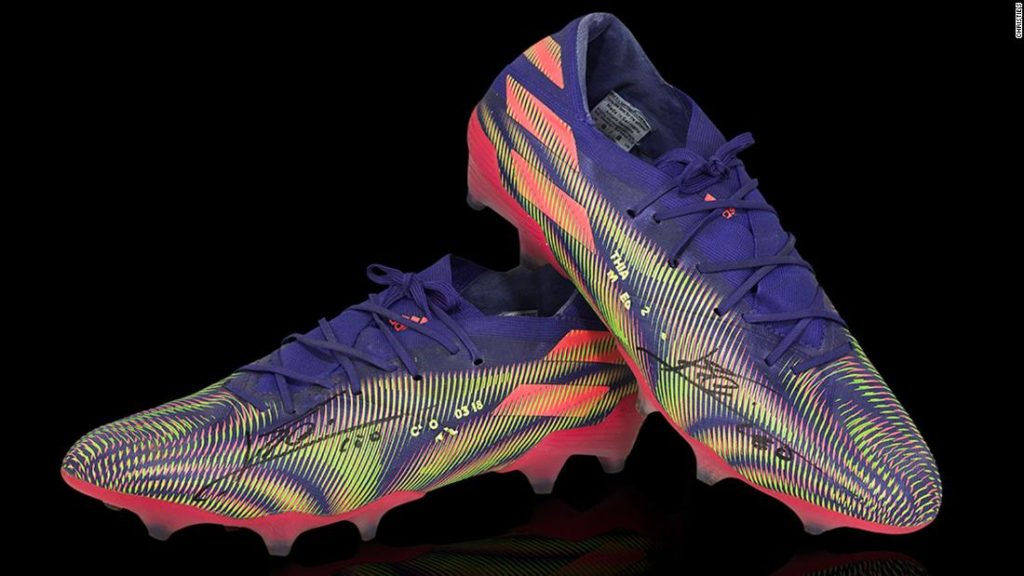 Lionel Messi: A pair of Barcelona star's football boots auctioned for $173,000