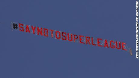 A plane flies over Elland Road in protest against the European Super League.