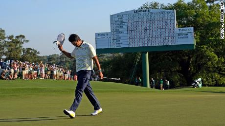 Matsuyama walks off the 18th green after winning the Masters.