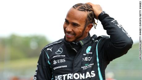 Lewis Hamilton celebrates his 99th pole position.