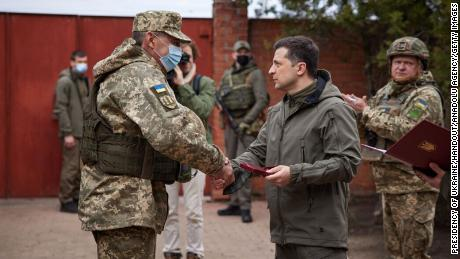 Ukrainian President Volodymyr Zelensky (right) handshakes with a soldier during his visit to a front in Donbas, Ukraine on April 08.