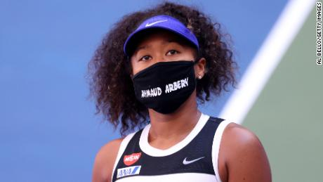 Osaka wears a protective face mask with the name Ahmaud Arbery stenciled on it after winning her women's singles third round match against Marta Kostyuk of the Ukraine on day five of the 2020 US Open.