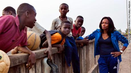 Isha Johansen speaking to a group of boys outside the National Stadium, in 2016.