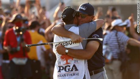Mickelson celebrates with brother and caddie Tim Mickelson on the 18th green after winning during the 2021 PGA Championship.