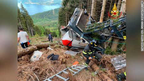 Rescuers work by the wreckage of a cable car after it collapsed near the summit of the Stresa-Mottarone line.