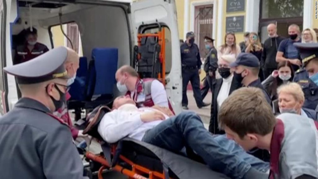 Belarusian activist Steffan Latypov stabs himself during a court hearing in Minsk
