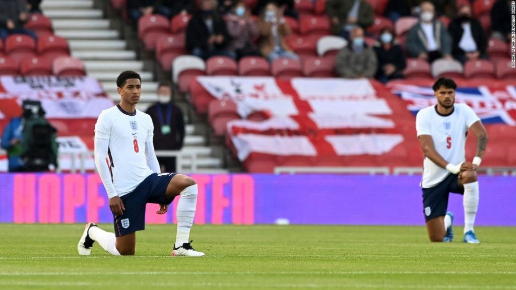 Euro 2020: Football's coming home, but taking a knee divides England fans