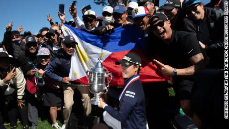 Saso celebrates with the Harton S. Semple trophy after winning the 76th U.S. Women's Open.