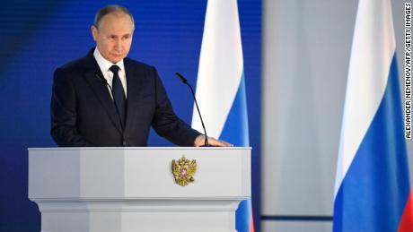 Russian President Vladimir Putin delivers his annual state of the nation address in Moscow on April 21.