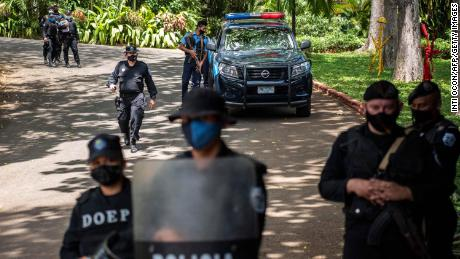 Riot police stand guard outside the house of pre-presidential candidate Cristiana Chamorro in Managua on June 2.