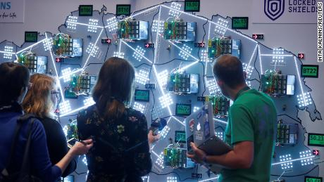 People look at the visualisation during the Locked Shields, cyber defence exercise organized by the NATO Cooperative Cyber Defence Centre of Exellence in Tallinn.